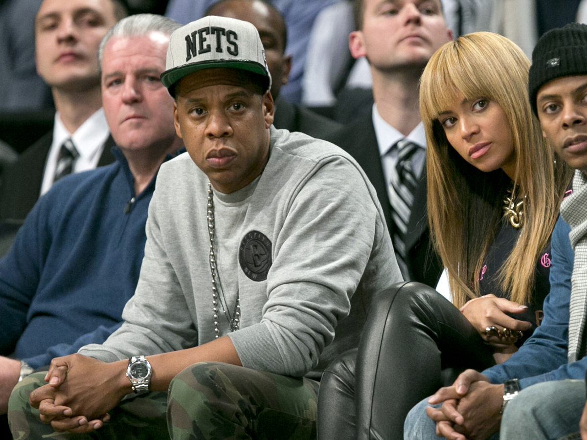 Entertainers Jay-Z and Beyonce watch Brooklyn Nets play New York Knicks in NBA game in New York