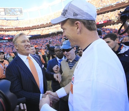 EVP of Football Operations for the Broncos John Elway congratulates his star QB on winning the AFC