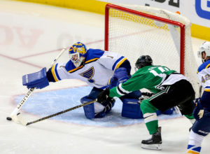 The Dallas Stars' Patrick Sharp (10) goes for the puck against St. Louis Blues goalie Brian Elliott (1) during the second period in Game 5 of the Western Conference semifinals at the American Airlines Center in Dallas on Saturday, May 7, 2016. The Blues won, 4-1, for a 3-2 series lead. (Steve Nurenberg/Fort Worth Star-Telegram/TNS) ORG XMIT: 1184466
