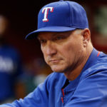 PHOENIX, AZ - APRIL 21:  Manager Jeff Banister #28 of the Texas Rangers watches from the dugout during the MLB game against the Arizona Diamondbacks at Chase Field on April 21, 2015 in Phoenix, Arizona.  (Photo by Christian Petersen/Getty Images)