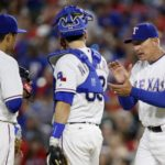 Apr 25, 2016; Arlington, TX, USA;  Texas Rangers manager Jeff Banister (28) goes to the mound to take starting pitcher Cesar Ramos (55) out of the game in the seventh inning against the New York Yankees at Globe Life Park in Arlington. New York won 3-1. Mandatory Credit: Tim Heitman-USA TODAY Sports